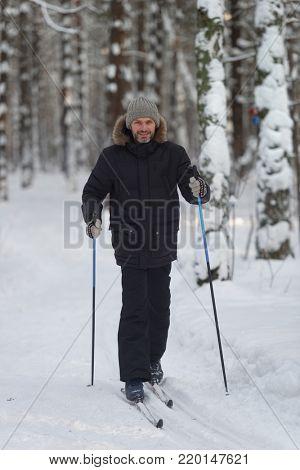 Mature man cross-country skiing