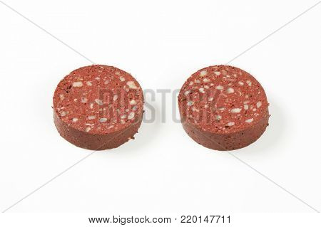 slices of blood sausage (black pudding) on white background