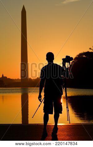 Photographers in the National Mall at sunrise - Washington DC United States