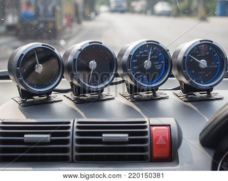 close up many gauge panel in the car
