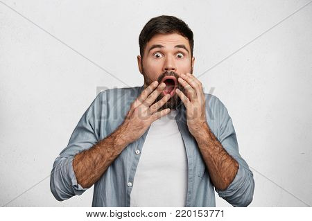 Photo Of Handsome Serious Bearded Man With Thick Black Mustache And Beard Wears Shirt, Looks Confide