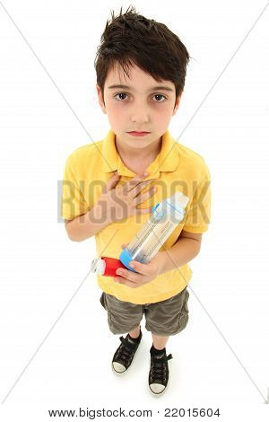 Asthmatic Child With Inhaler And Spacer Chamber