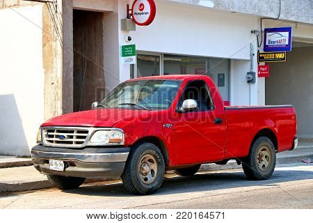 Emiliano Zapata, Mexico - May 23, 2017: Red pickup truck Ford F-150 in the city street.