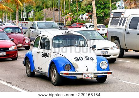 Acapulco, Mexico - May 30, 2017: Blue taxi car Volkswagen Beetle in the city street.