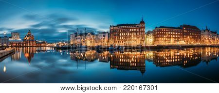 Helsinki, Finland. Panoramic View Of Kanavaranta Street With Uspenski Cathedral And Pohjoisranta Street In Evening Night Illuminations.
