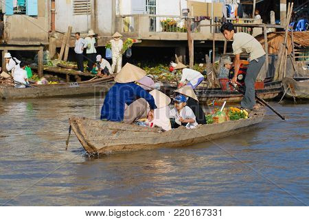 CAI BE, VIETNAM - FEBRUARY 16, 2007: Unidentified people visit famous floating market in Cai Be, Vietnam. Cai Be is often called Venice of Indochina.