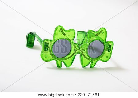small pair of st-patties days sunglasses against white background