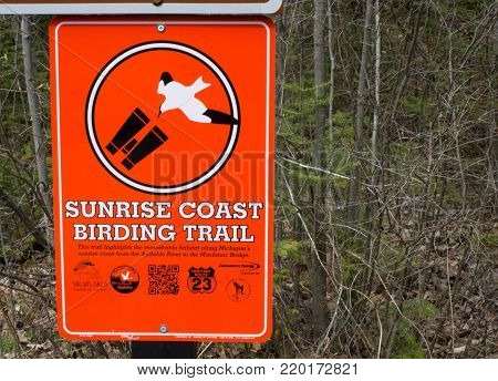 Cheboygan, Michigan, USA - May 9, 2015: Sign for the Sunrise Coast Birding Trail. The trail follow the migratory path of birds from the Au Sable River valley to the Straits of Mackinaw in Michigan.