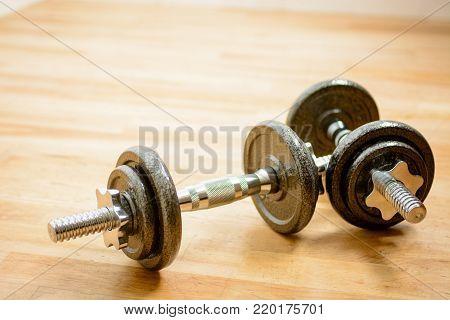 Gym Training - Set of Dumbells on wooden floor