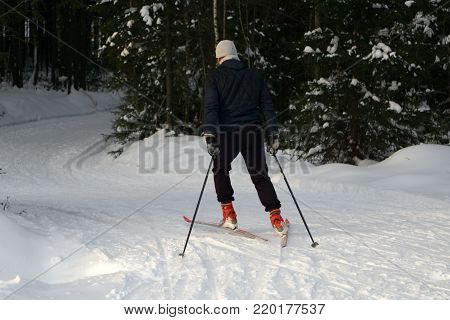 A young man rides cross-country skiing. Active winter. Active guests. Amateur sports
