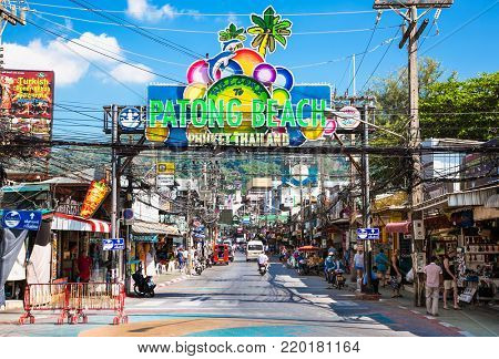 PHUKET, THAILAND - JAN 23, 2016: Patong Beach welcome sign above entrance to Bangla Road in Phuket on Jan 23, 2016, Thailand. Bangla Road is a famous tourist place full of bars, shops and discos.