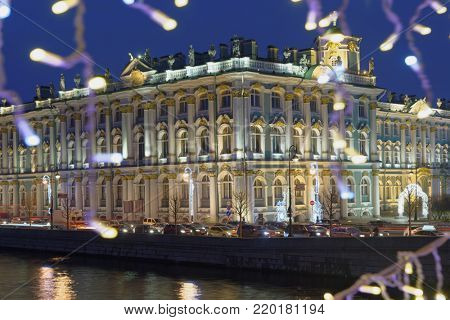 ST. PETERSBURG, RUSSIA - DECEMBER 18, 2017: Winter Palace viewed from Palace bridge decorated for Christmas. Christmas street decorations comprise of 2606 garlands and light elements