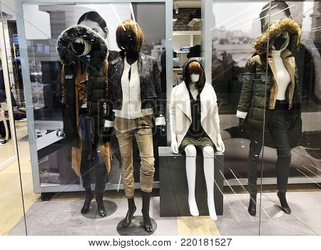 RISHON LE ZION, ISRAEL- DECEMBER 29, 2017: Luxury and fashionable brand window display. Casual clothing and bag showcase in front of the store.