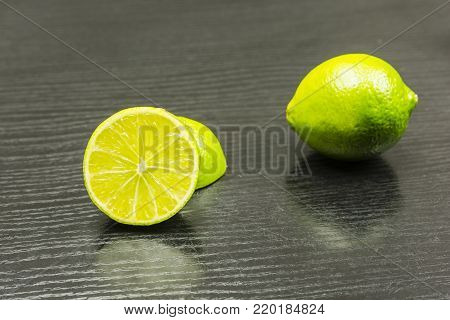Cross-section of a West Indian lime fruit on the table.