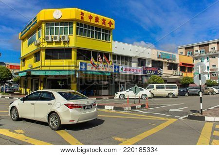 Labuan,Malaysia-Sept 30,2017:Street view of Chinese shop house & duty free shop in Labuan,Malaysia.The duty free products like alcohol & cigarette are among the main attractions of the island.