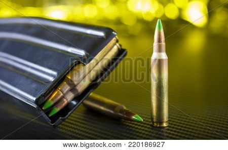 Ammunition with gree tips that go in an AR-15 and a magazine