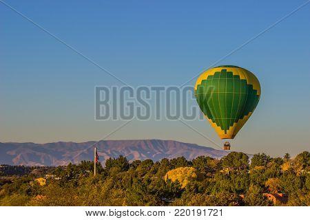 Hot Air Balloon At Low Altitude In Arizona High Desert