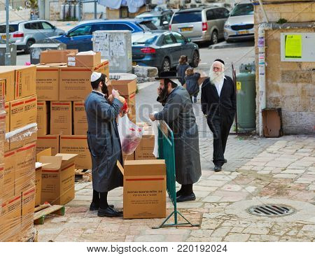 JERUSALEM, ISRAEL - DECEMBER 29, 2016: Two Hasidim talk in Mea Shearim quarter one of oldest districts in Jerusalem. quarter was founded in 1874 by Zalman Baharan and Joseph Rivlin