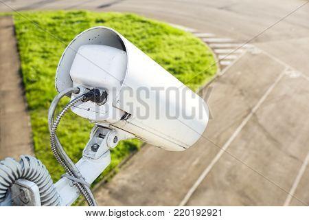 vSecurity camera, CCTV in car park building .