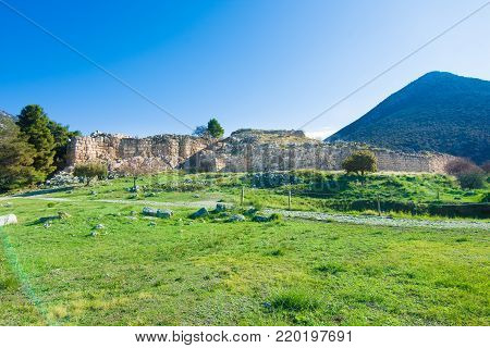 The archaeological site of Mycenae near the village of Mykines, with ancient tombs, giant walls and the famous lions gate,  Peloponnese, Greece