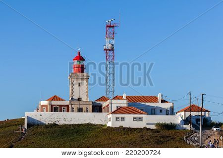 Sintra, Portugal, August 8, 2017: The Cape Roca lighthouse, overlooking the Atlantic Ocean. Cape Roca forms the westernmost extent of mainland Portugal, continental Europe and the Eurasian land mass.