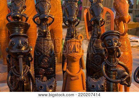 Clay made dolls , terracotta handicrafts, tribal art of Bankura and Bishnupur , on display during the Handicraft Fair in Kolkata , West Bengal, India. It is the biggest handicrafts fair in Asia.