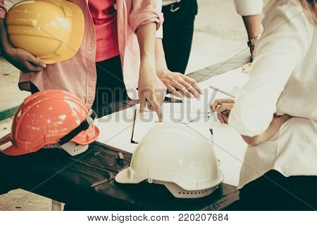Asian engineer concept Teamwork of building construction. Project contractor reviewing plan work in construction site.