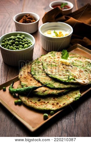 Green peas stuffed paratha or matar ka paratha, which is a traditional and popular food native to north India, made from dough of wheat flour and green peas or matar, served with mango pickle, curd bundi etc