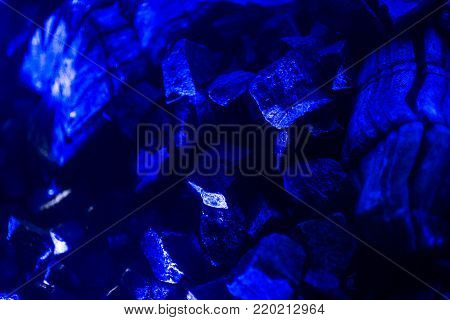 Blue Stone wet for construction, wet Stone blue dark background, Rocks for construction work