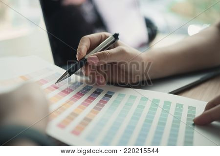 Graphic Or Interior Designer Choosing Color From Swatch Sample Or Catalogue Palette Guide At Workpla