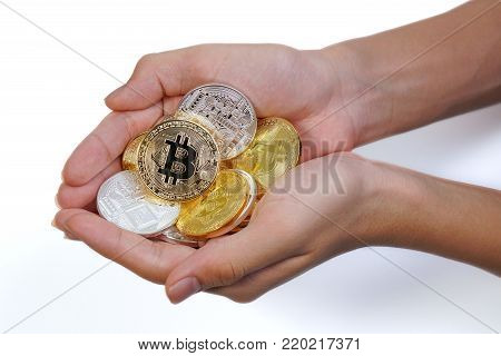 Asian Young Hand Holding Up Many Golden Bitcoin And Silver Bitcoin In Two Hand. Close Up Of Bitcoin
