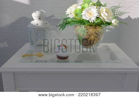 bouquet of artificial flowers is on a tidy table