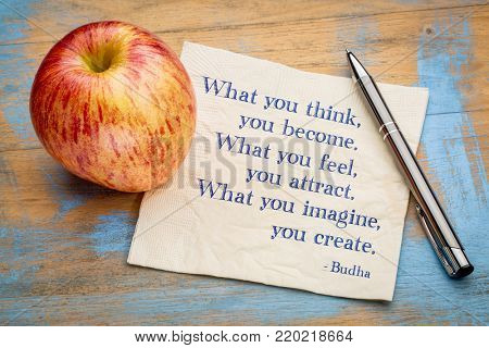 What you think, feel, imagine ... Budha quote. Inspirational handwriting on a napkin with a fresh apple