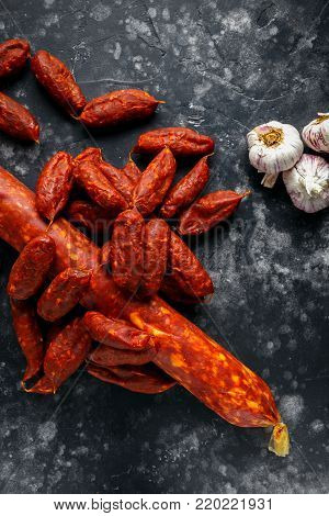 Variety of dry cured Spanish pork chorizo sausages made with paprika and garlic.