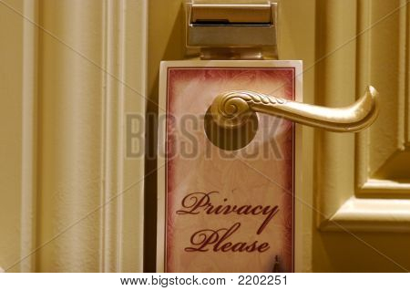 A Privacy Sign Leading Into A Luxurious Hotel Suite