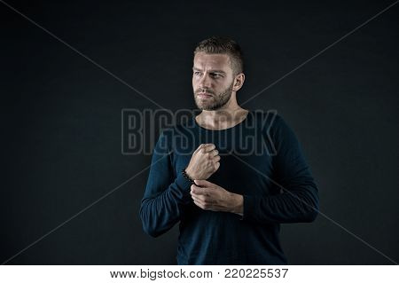 Macho In Sweater Pose With Folded Hands