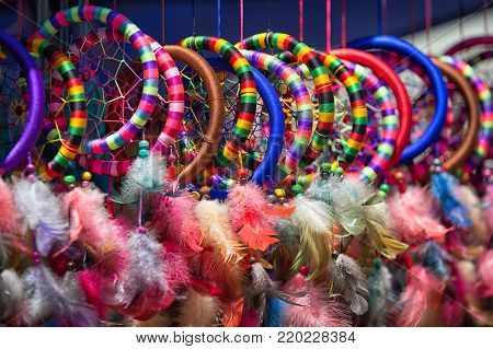 Otavalo, Ecuador - December 16, 2017: colorful indigenous crafts for sale in the Saturday artisan market