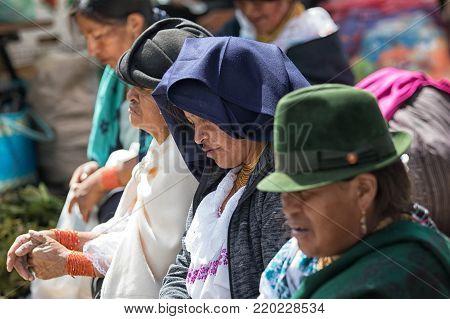 Otavalo, Ecuador-December 23, 2017: closeup of indigenous women wearing tradition clothing
