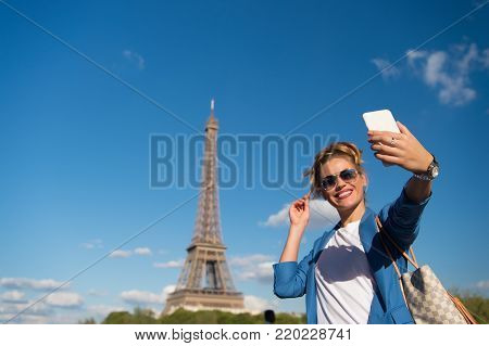Woman At Eiffel Tower In Paris, France On Blue Sky