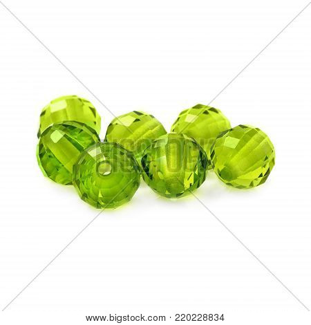 Peridot color beads on a white background.