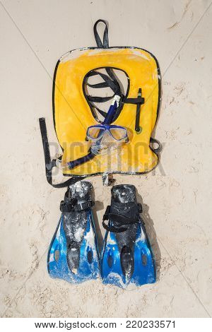 Life Jacket And A Mask For Snorkeling On Sand