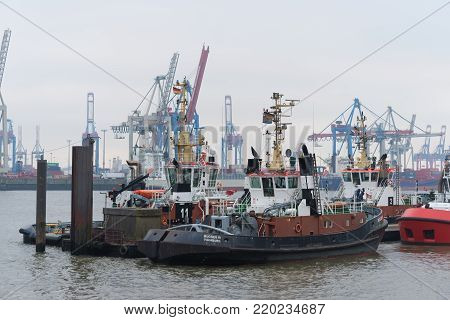 HAMBURG, GERMANY - DECEMBER 20, 2016: Tug boats waiting to come n action in the Hamburg port area