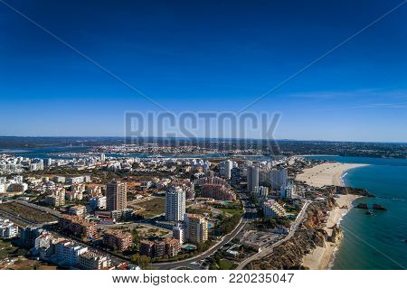 Aerial view of the coastline in Rocha Beach (Praia da Rocha) in Portimao, Algarve, Portugal; Concept for travel in Portugal and Algarve