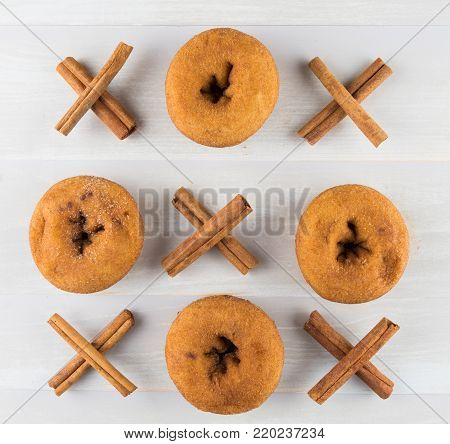 Tic Tac Toe with Donuts and Cinnamon Sticks Tied in Xs