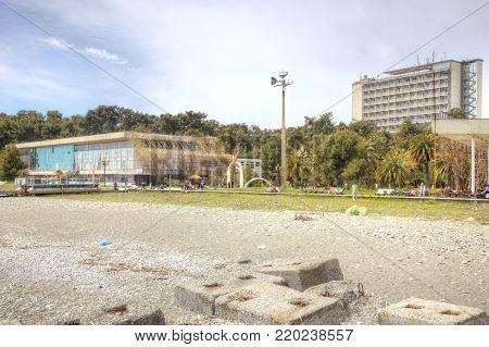 PITSUNDA, ABKHAZIA - April 26.2015: Sanatorium-resort complex ashore the Black sea. The city beach and promenade climatic resort