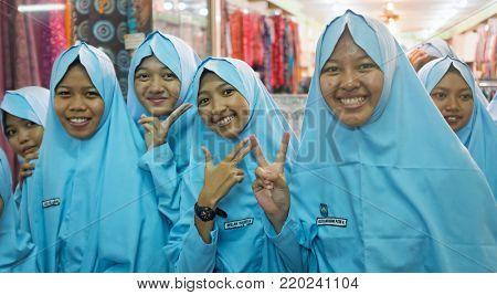 JAVA, INDONESIA - DECEMBER 16, 2016: Religious women in town doing shopping on Java Indonesia on 16th december 2016