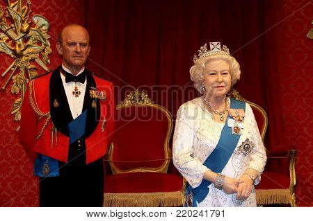 London, - United Kingdom, 08, July 2014. Madame Tussauds in London. Waxwork statue of Prince Philip, Duke of Edinburgh. and Queen Elizabeth 11, Created by Madam Tussauds in 1884.