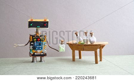 Friendly robot medic pharmacist testing modern pills and antibiotics in glass bottles. Creative design mechanic toy laboratory interior. Gray wall, green floor