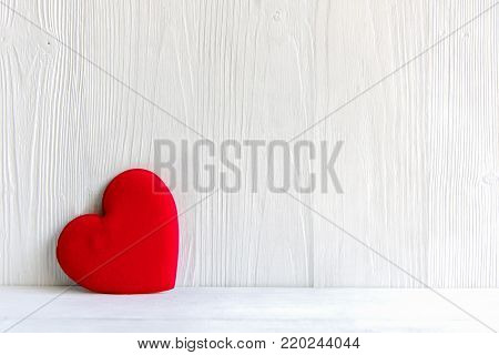 Valentine's Day.  Sewed pillow red hearts clothespins on the white wood planks. Happy lovers day card mockup, copy space.  Valentine Concept