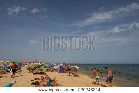 MANTA ROTA, PORTUGAL - AUGUST 25, 2017: People at the famous beach of Manta Rota in Algarve. This beach is a part of famous tourist region of Algarve.